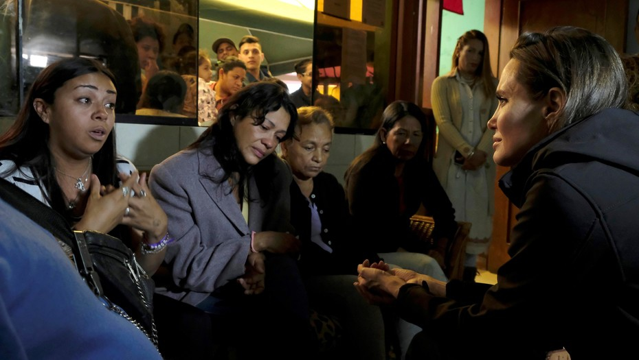 Angelina Jolie, speaking here in Lima, Peru, has been accused of helping distract attention away from the US-bound migratory march. (Geert Vanden Wijngaert / AP)