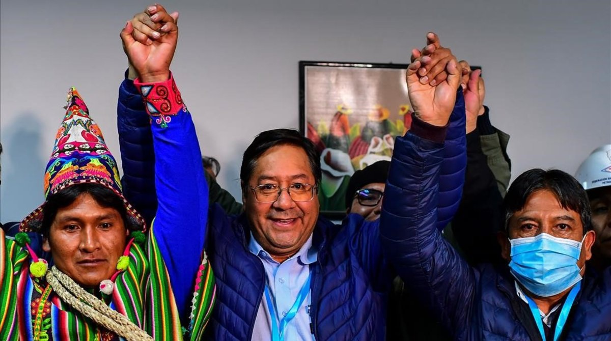 Luis Arce (centre) won Sunday's presidential elections in Bolivia for the progressive MAS party. (AFP)
