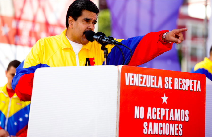 "President Maduro speaks on a platform with the message ""Venezuela is to be respected, we dont accept sanctions"" (Archive)"