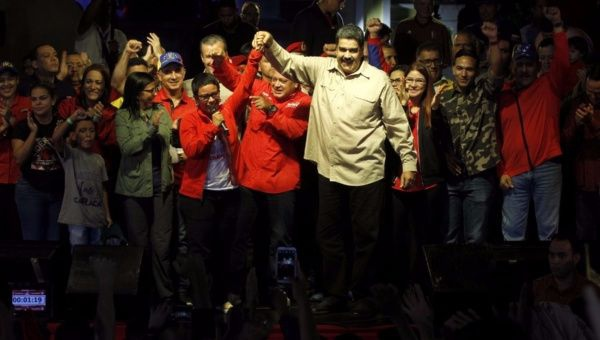 Venezuela's President Nicolas Maduro celebrates the outcome of Sunday's municipal elections with the newly elected mayor of Libertador district Erika Farias in Caracas. (AVN)