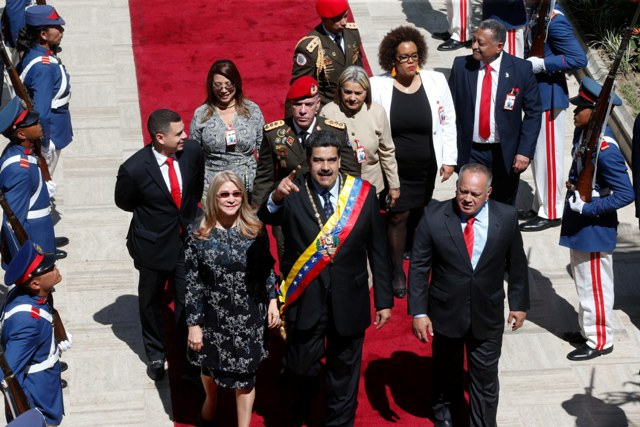Maduro arrives at the Legislative Palace to present his annual address alongside his wife, Cilia Flores, and the President of the ANC Diosdado Cabello. (Tom Grillo)