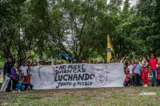 "A vigil is held for the three murdered campesinos in Barinas state, with the banner reading ""Those who fall in the people's struggle can't be considered dead"" (Aporrea)"