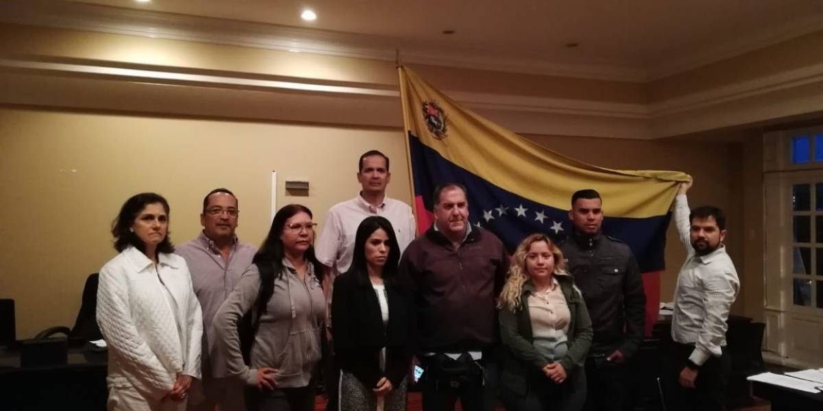 María Faría (centre, black jacket) took control of the Venezuelan Embassy in Costa Rica alongside a team of legal advisors (Courtesy, La Nacion).