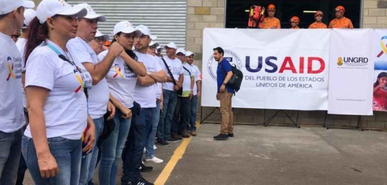 "Volunteers supporting self-declared ""Interim President"" Juan Guaido line up next to USAID personnel in Cucuta, Colombia (Version Final)"