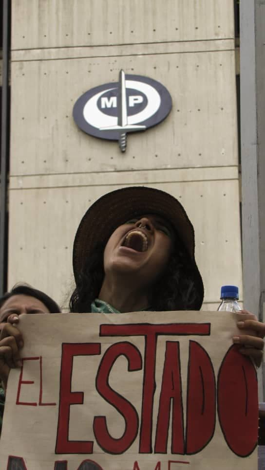 One of the major issues was authority's failure to take action on issues including femicides, legalising abortion and the macho culture still in place in the country. Here a protestor makes a stop off at the attorney general's offices. (Michelle Mata)