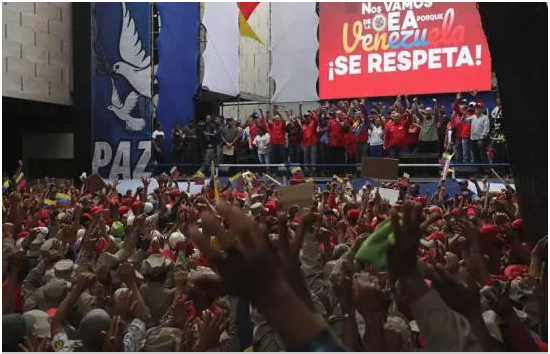 """We are leaving the OAS because Venezuela is to be respected"" reads the screen at the culmination of the march to celebrate the countries withdrawal from the regional bloc. (EFE)"