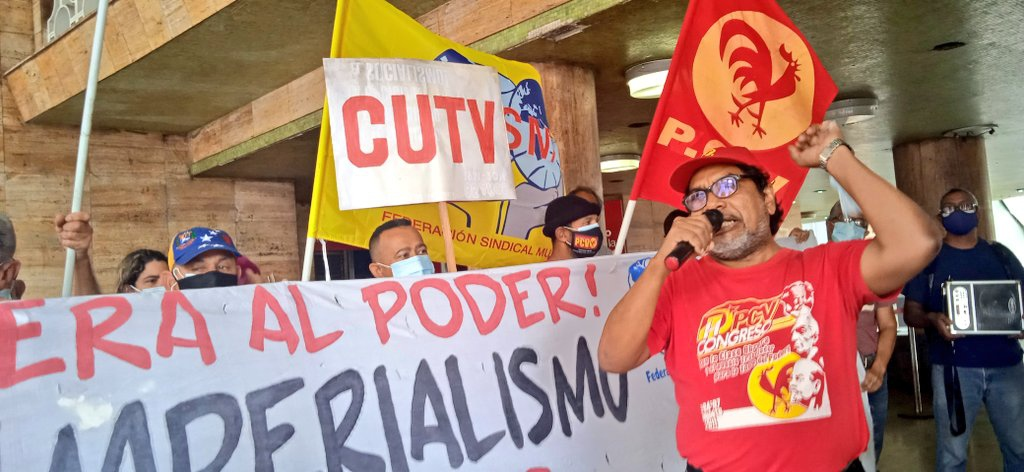 Communist Deputy Oscar Figuera leads a May Day protest outside the Labor Ministry in Caracas. (@OscarFigueraPCV / Twitter)