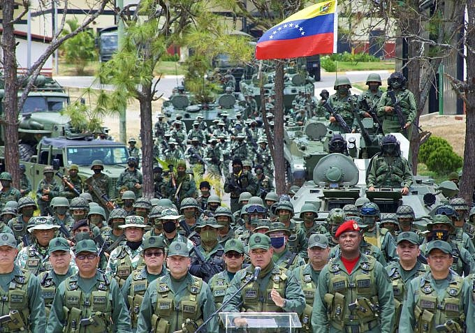 Defense Minister Padrino Lopez gave a press conference praising the armed forces' response to the paramilitary attack. (TeleSur)