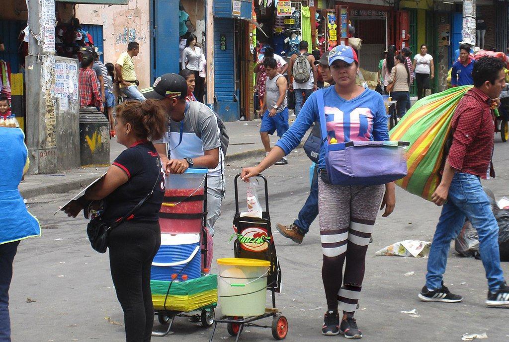 Venezuelan migrant selling arepas in Peru (Wikipedia)