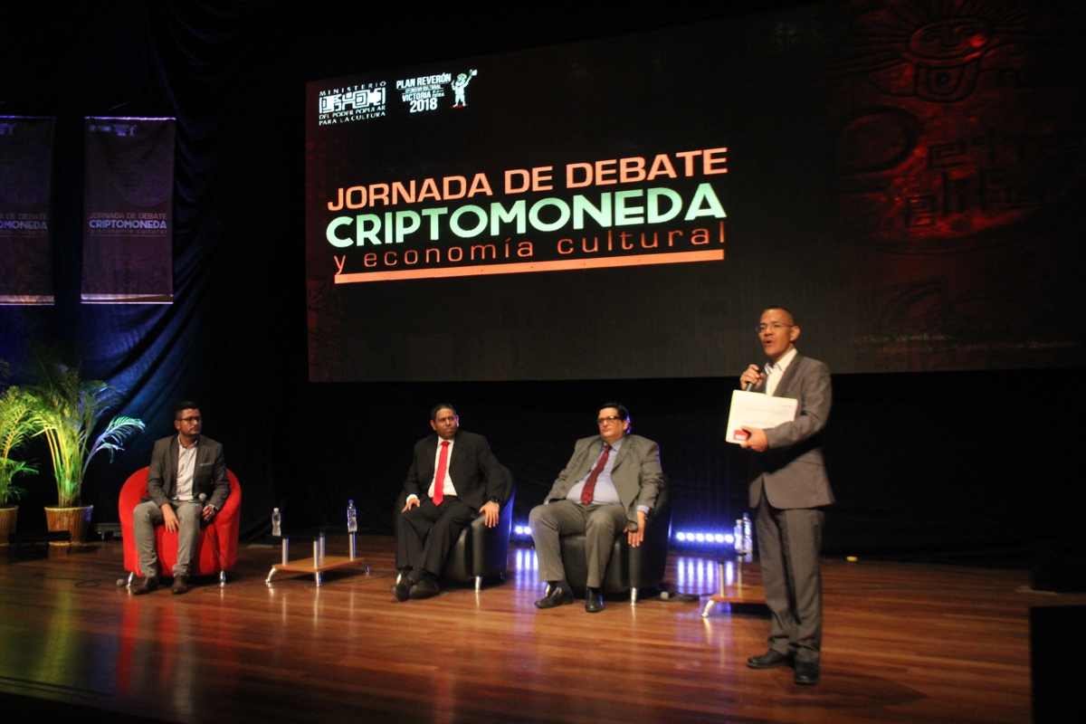 Culture Minister Ernesto Villegas speaking in a forum dedicated to cryptocurrencies
