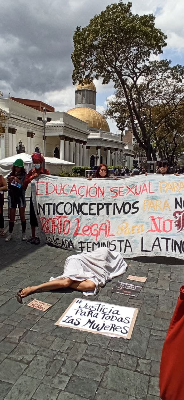 This dramatic protest symbolised the increasing number of women killed by their spouses, ex-spouses, or other male family members. (Karina Alviarez)