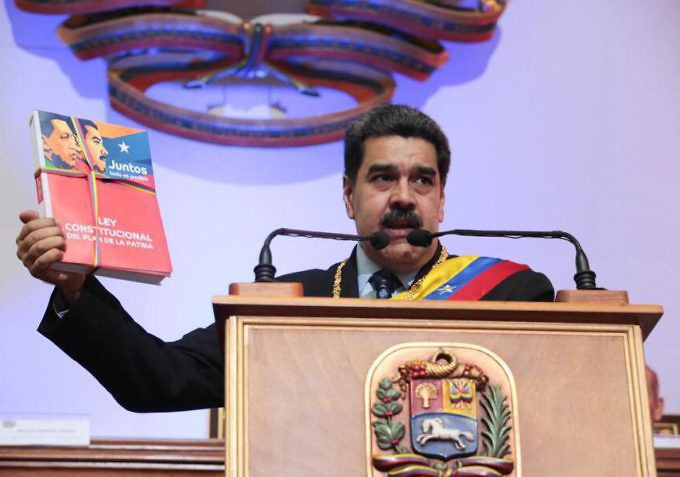 President Maduro holds up his Homeland Plan (Presidential Press)