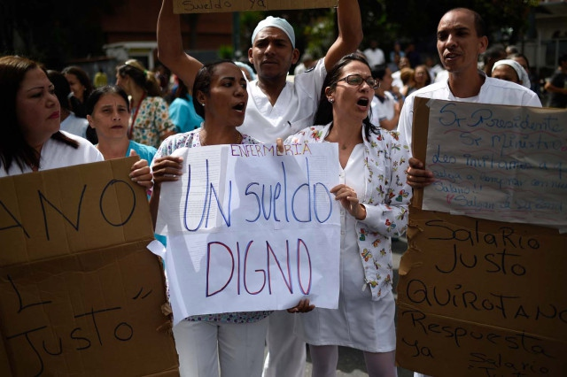 Nurses on strike outside Caracas' Central University Hospital. (Federico Parra / AFP)