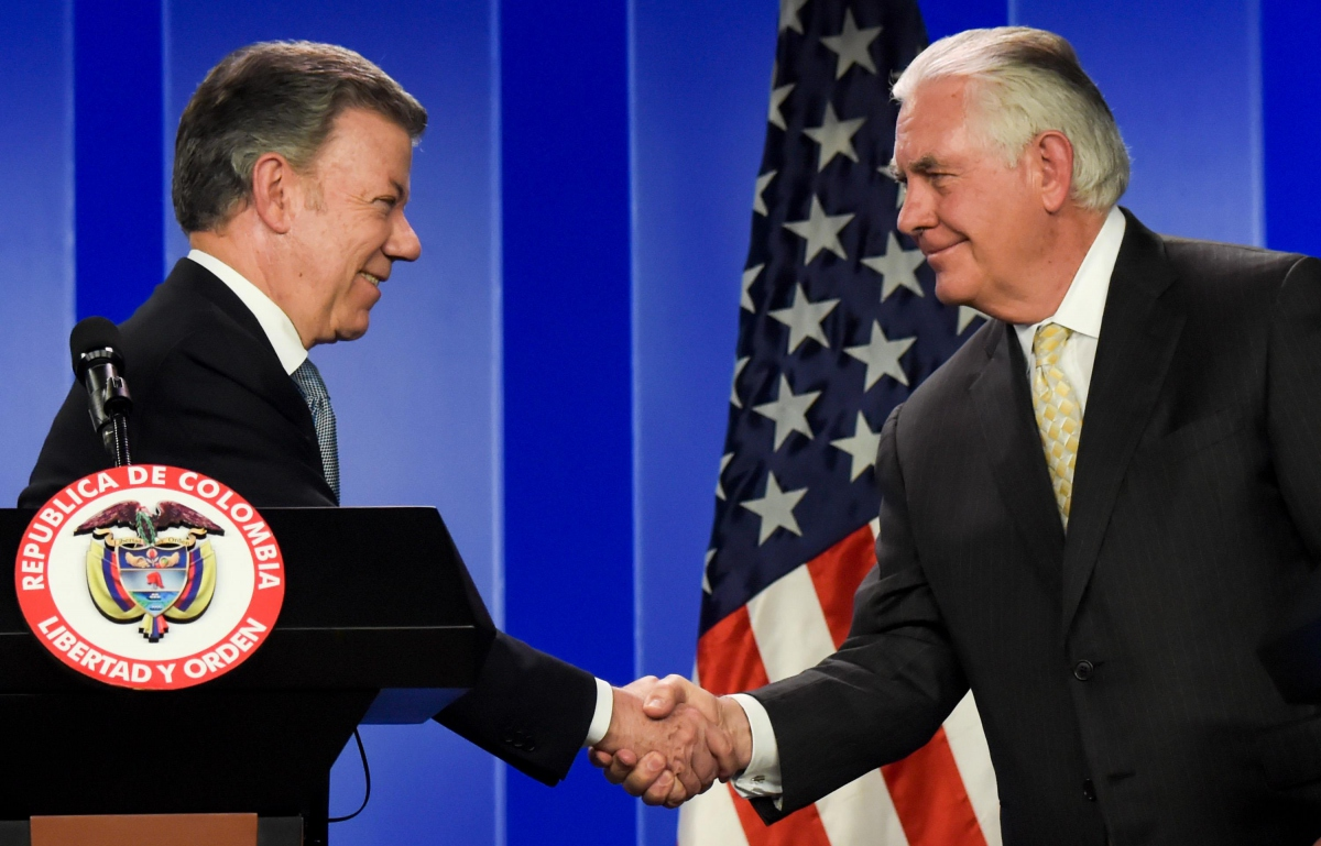 US Secretary of State, Rex Tillerson, shakes hands with Colombian President Santos during a recent tour of the region (AFP)