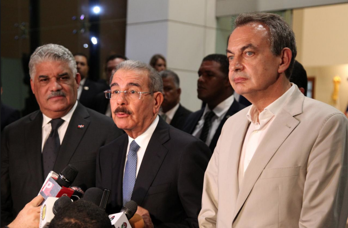 Dominican Republic Foreign Minister Miguel Vargas, DR President Danilo Medina, and former Spanish Prime Minister José Luis Rodríguez Zapatero are overseeing the Venezuelan dialogue. (Reuters)