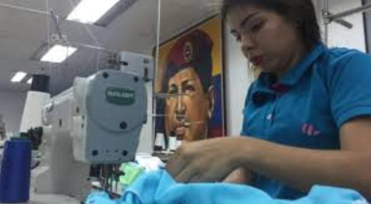 """Abejitas de El Panal"" is an associated work collective that produces clothing. (Comuna El Panal)"