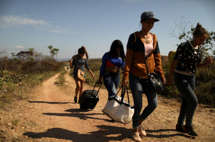 Reuters depiction (6/7/19) of Venezuelan refugees. (Pilar Olivares/Reuters)