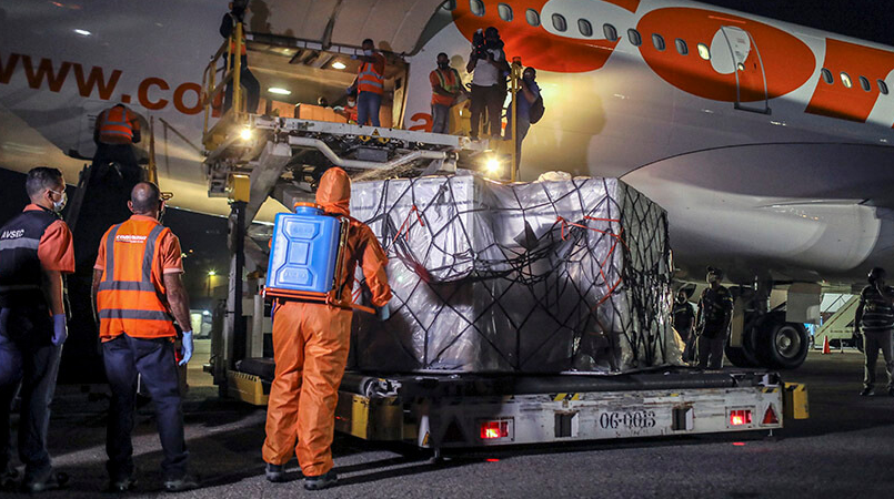 A shipment of medical implements from China arrives to Venezuela, March 2021. (Leonardo Fernández Viloria/Reuters)