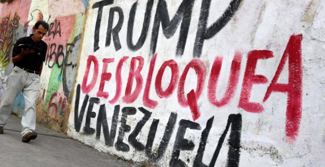 """A mural in Caracas reads """"Trump unblock Venezuela."""" (MinCI)"""