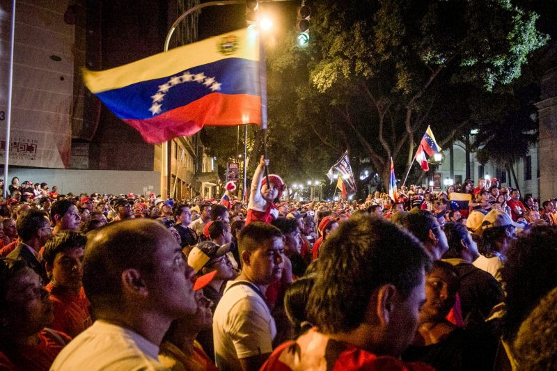 Venezuelans wait for election results near Miraflores Palace in Caracas. (thetricontinental.org)