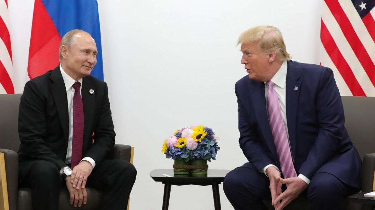 Russian President Vladimir Putin talks to US President Donald Trump at the G20 meeting in Osaka, Japan. (Susan Walsh / AP)