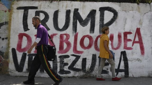 "A mural in Caracas reads ""Trump unblock Venezuela."" (BBC)"