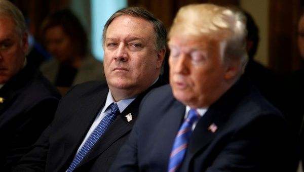 U.S. Secretary of State Mike Pompeo next to President Donald Trump. (Reuters)