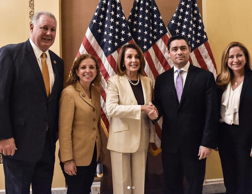 Vecchio with Democratic congressional leaders including Nancy Pelosi and Debbie Wasserman-Schultz. (Archive)