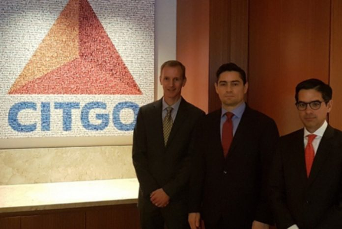 Carlos Vecchio (centre) at the CITGO offices in March (Agencies).
