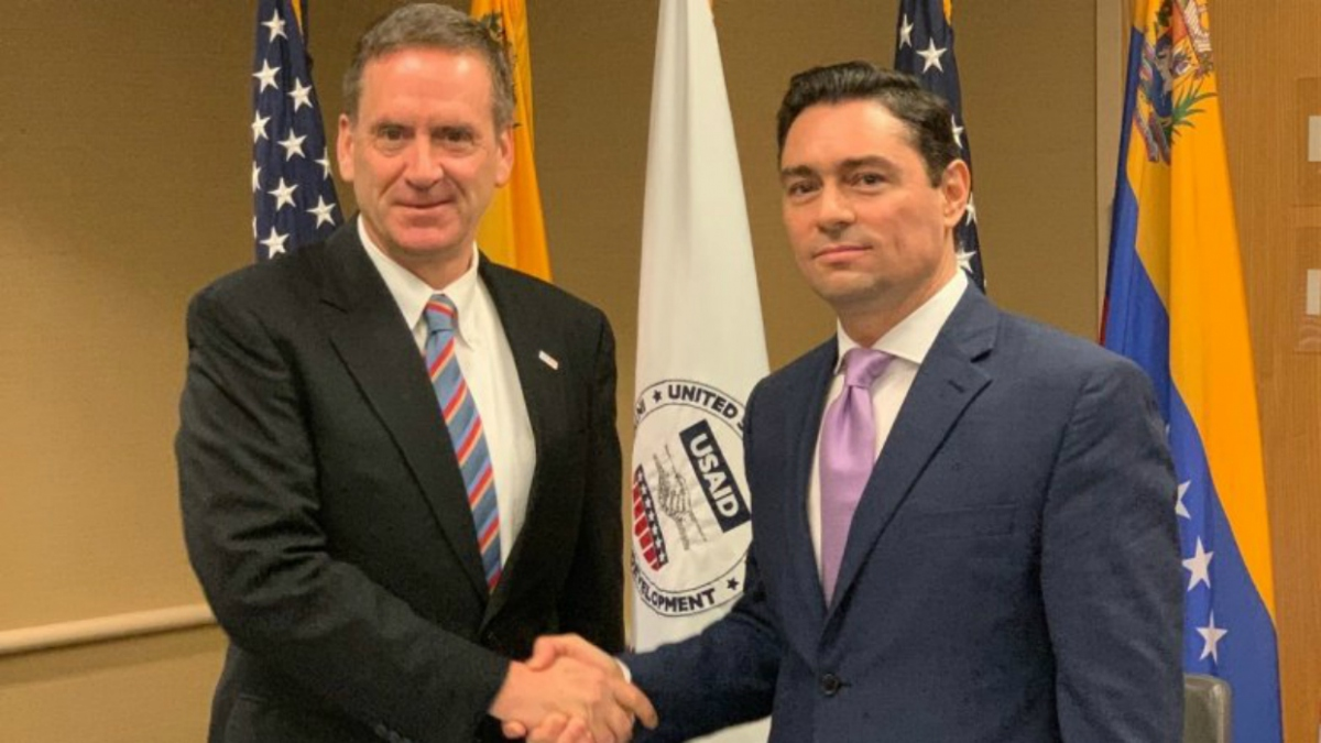 USAID director Mark Green and Guaido representative in the US Carlos Vecchio. (AFP)