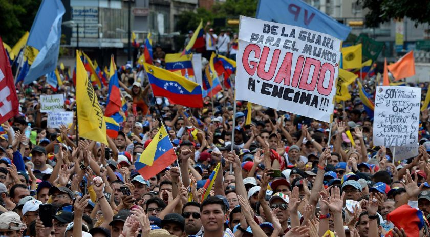 """""""Guaido on top, from the Guaira to the world"""" reads this banner from one of his supporters (AFP)"""