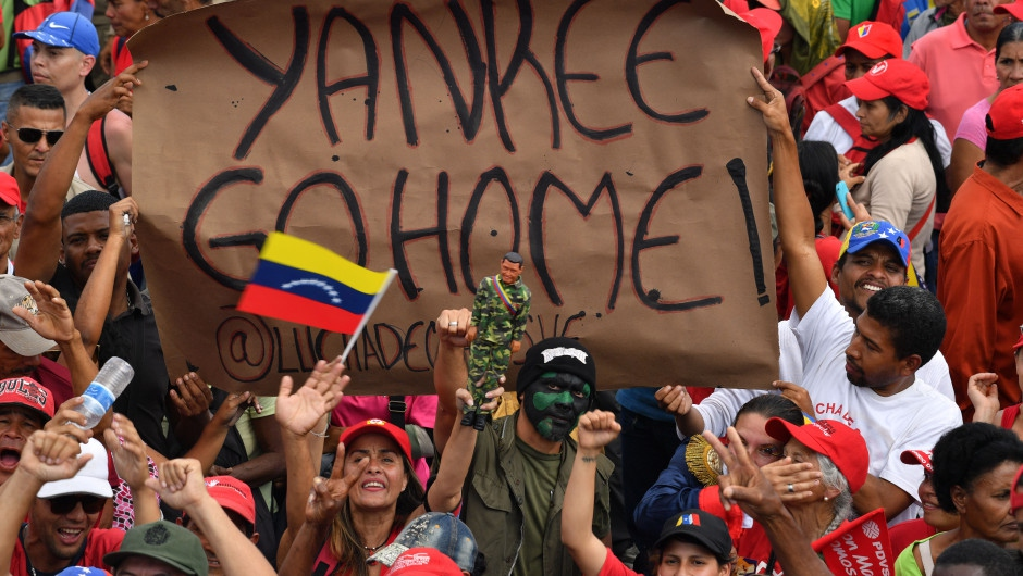 Maduro supporters hold a banner reading Yankee Go Home (Yuri Cortez / Getty Images)