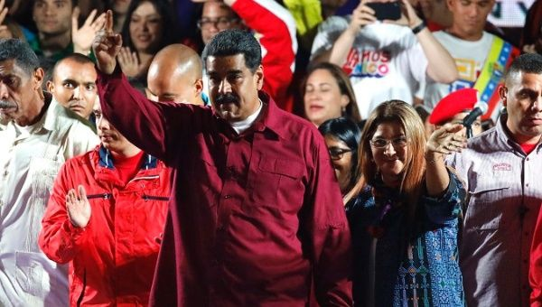 President Nicolas Maduro addresses supporters gathered at Miraflores Palace on Sunday evening. (Reuters)