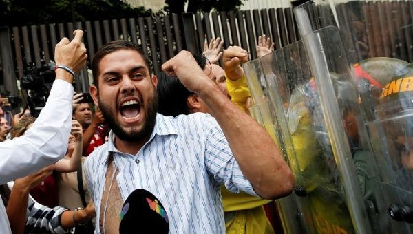 Detained opposition legislator Juan Requesens during protests in 2017. (Reuters)