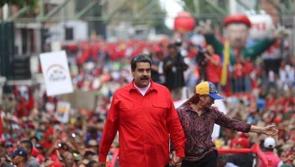 Venezuela's President Nicolas Maduro and his wife Cilia Flores attend a rally with supporters in Caracas (Reuters).