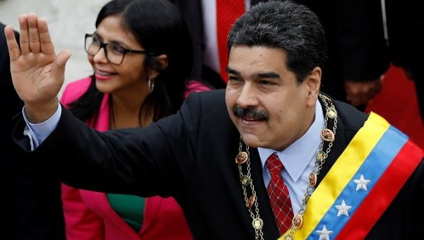 Venezuelan President Nicolas Maduro arrives to give his annual address to the nation, accompanied by Constituent Assembly President Delcy Rodriguez. (Reuters)