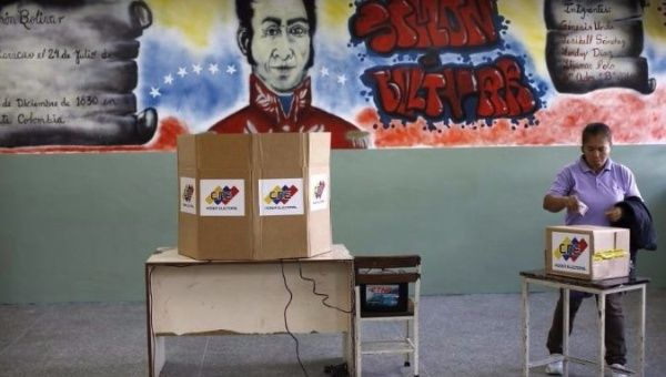A woman casts her vote at a polling station during the Constituent Assembly election in Caracas, Venezuela. (Reuters)