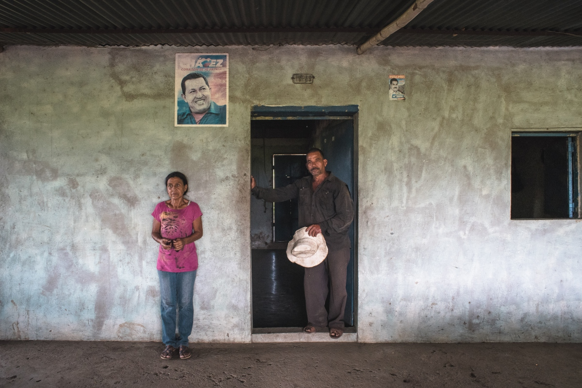 A picture of former President Hugo Chavez hangs on a wall. (Marcelo Volpe)