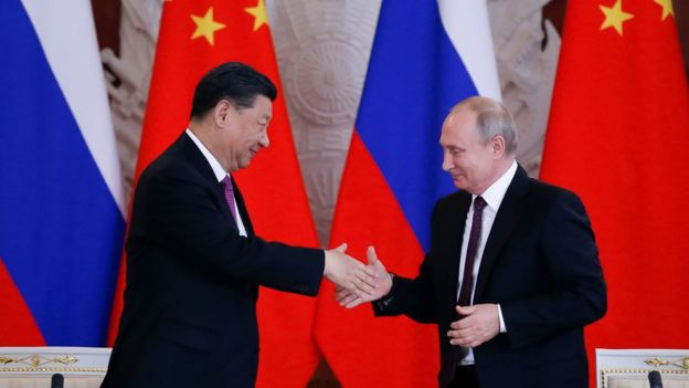 "Chinese President Xi Jinping and Russian President Vladimir Putin shake hands during their meeting at the Grand Kremlin Palace on Wednesday in Moscow. Xi called Putin his ""best friend"" on the visit. (AFP)"