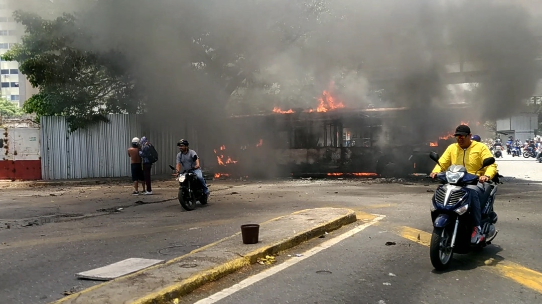 Opposition protesters burned a public bus in Altamira, east Caracas. (Katrina Kozarek)