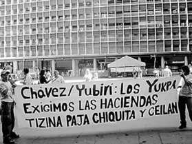 """A protest sign in support of the Yukpa reads: """"Chávez/[Environment Minister] Yubirí: The Yukpa demand the Tizina, Paja, Chiquita, and Ceilan Estates."""" (ANMCLA)"""