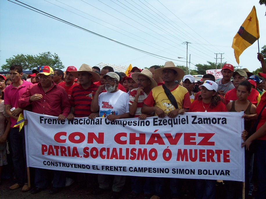 """""""With Chavez, Homeland, Socialism, or Death,"""" reads a banner at Thursday's march (FNCEZ website)"""