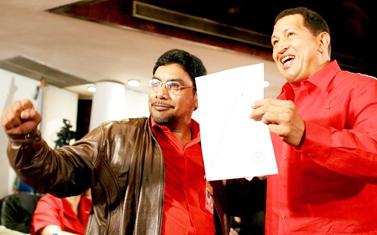 President Hugo Chavez (right) and PCV General Secretary Oscar Figuera (PCV)