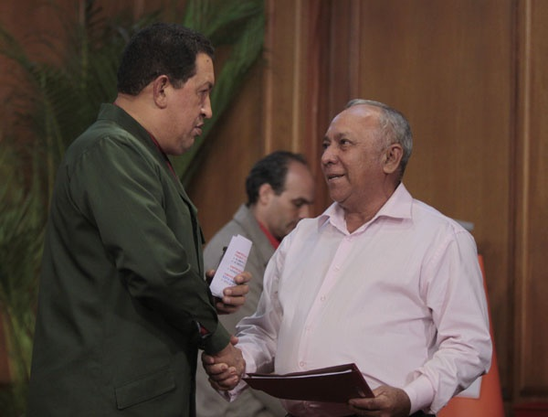 President Chavez grants a low-interest loan to a small