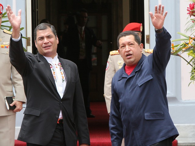 Venezuelan President Hugo Chavez and Ecuadoran President Rafael Correa wave as they enter the VIII Presidential Meeting between their respective countries (RNV).