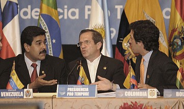At the UNASUR meeting; Venezuelan Foreign Minister Nicolas Maduro (left), Ricardo Patino, Ecuadorian Foreign Minister Ricardo Patino (middle) and Colombia's Foreign Minister Jaime Bermudez (right) (Telesur).