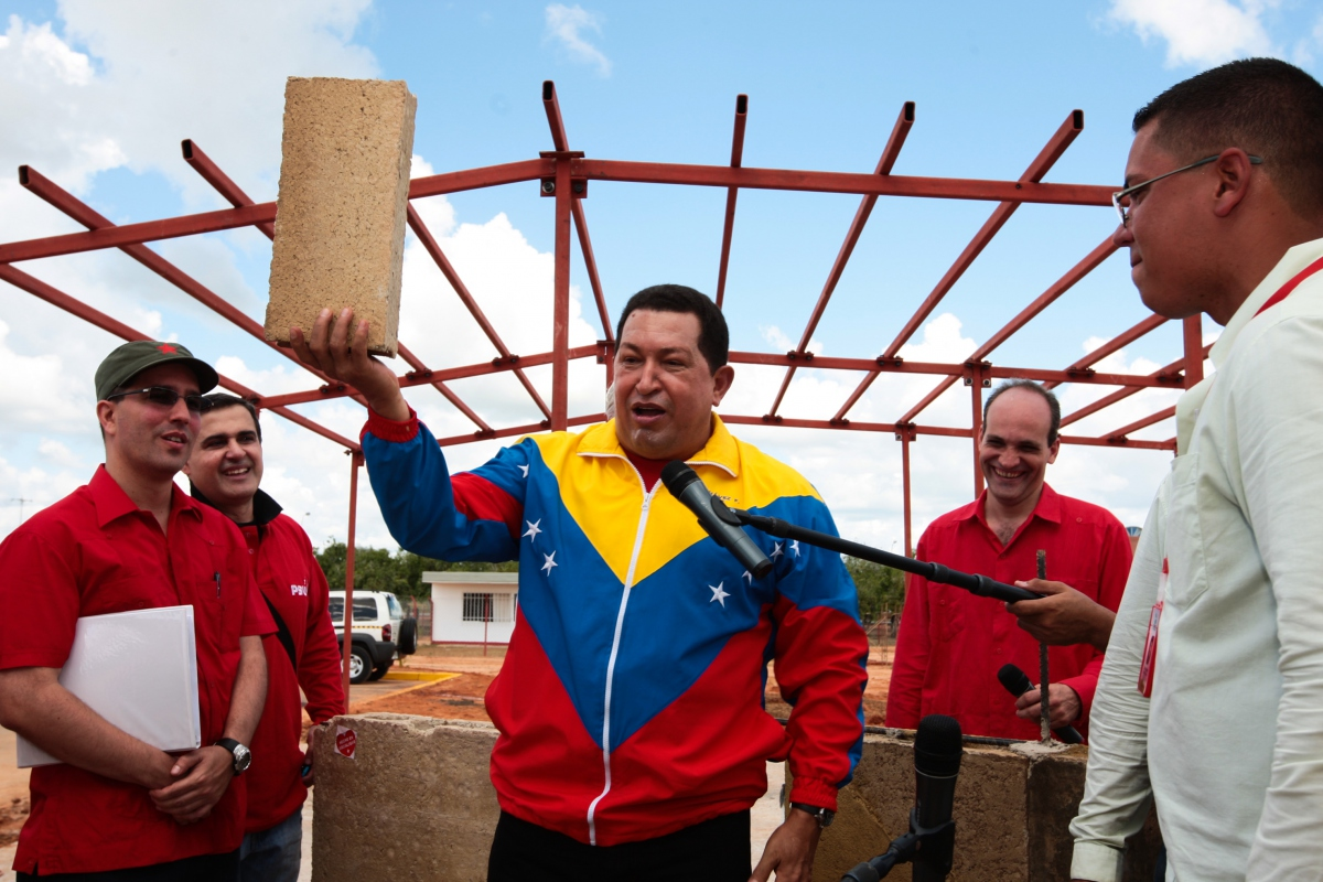 President Chavez holds up a brick made of 40% recycled paper (Prensa Miraflores).