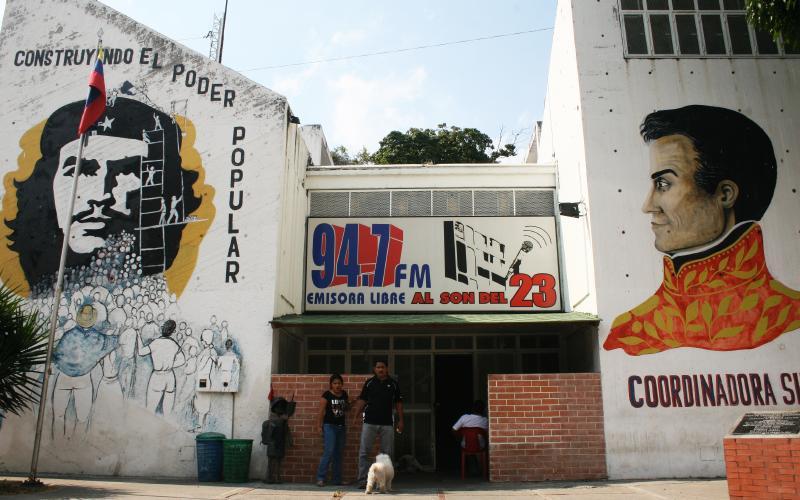 "(Left) ""Constructing Popular Power,"" (center) ""94.7FM Free Radio to the rhythm of 23 [de Enero barrio]"""