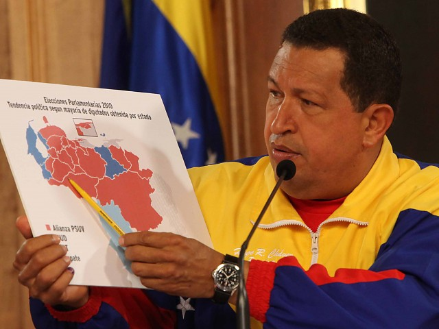 President Chavez shows a colored map during a press conference on Monday (ABN)