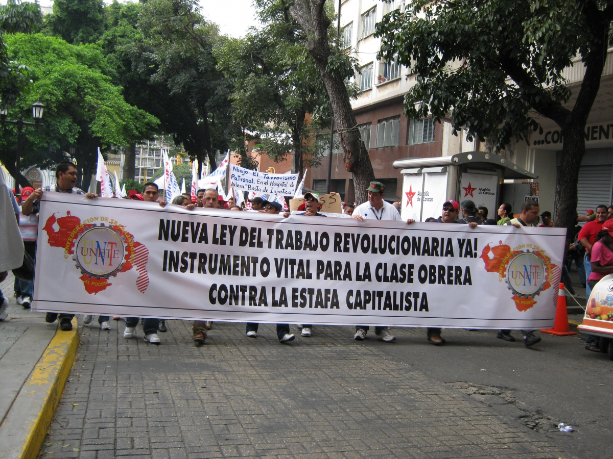 "Marchers carried banners such as this one that read, ""New Revolutionary Labour Law Now! Vital Instrument for the Working Class Against Capitalist Fraud!"" (Venezuelanalysis.com)"